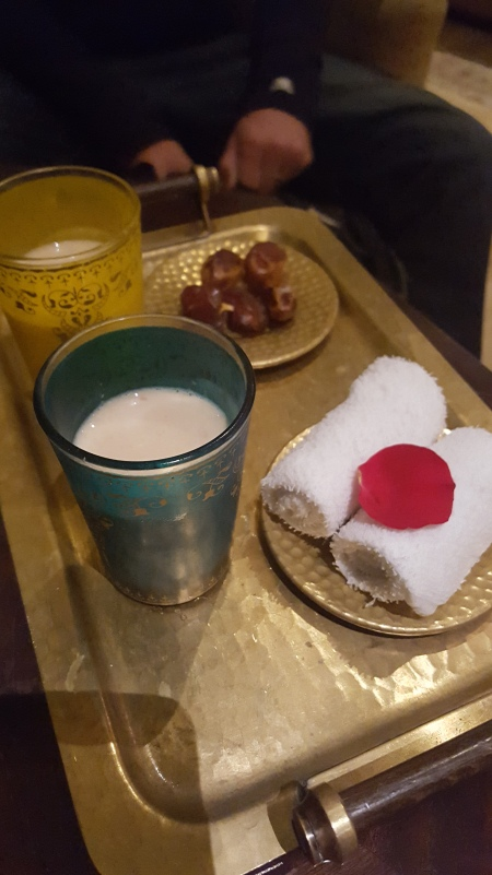 Camel's milk, dates and a cold towel for our welcoming.